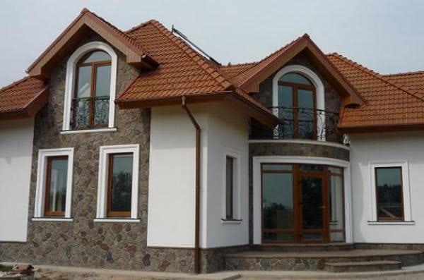 Дом отделанный минеральной шпатлевкой
