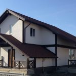 Отштукатуренный фасад деревянного дома