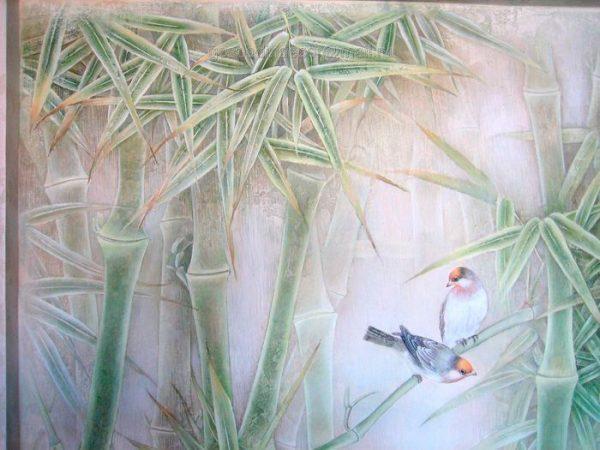 Фигурки птиц на стене