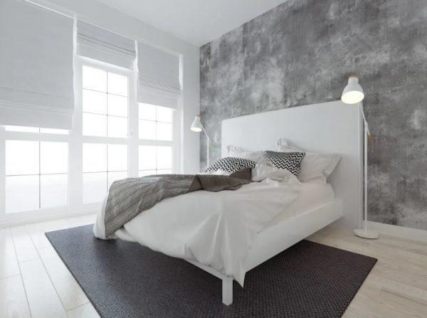 Спальная комната с бетонной стеной